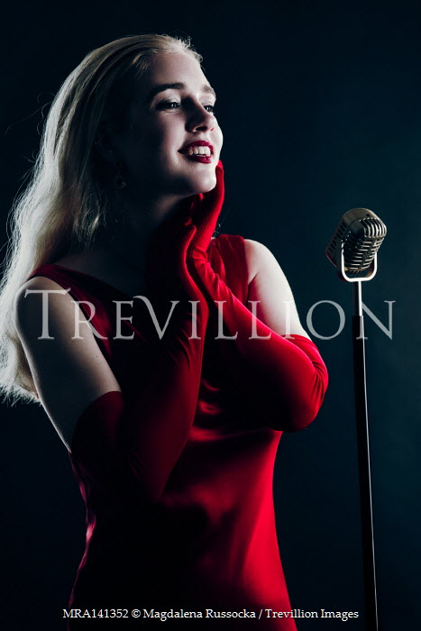 Magdalena Russocka retro woman wearing red dress performing on stage