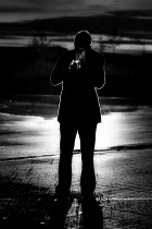 Andreas Overland MAN IN SILHOUETTE SMOKING CIGARETTE Men