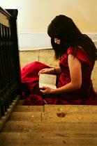 Stuart Brill WOMAN READING ON STAIRS Women