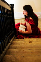 Stuart Brill WOMAN SITTING ON STAIRS Women