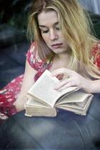Yolande de Kort woman sitting down reading Women