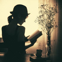 Esmahan Ozkan SILHOUETTE OF WOMAN READING BOOK Women