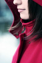 Esmahan Ozkan CLOSE UP OF WOMAN IN HOODED COAT Women