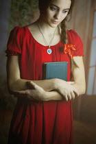 Ildiko Neer YOUNG WOMAN HOLDING BOOK Women