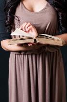 Mohamad Itani WOMAN HOLDING OPEN BOOK Women