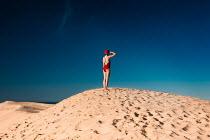 Amelie Satzger WOMAN IN SWIMSUIT SALUTING SEA Women