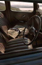 CollaborationJS GUN AND NEWSPAPER INSIDE RETRO CAR Cars