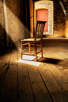CollaborationJS wooden chair in shadowy warehouse Interiors/Rooms
