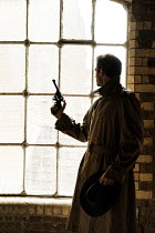 CollaborationJS shadowy retro man with gun by window Men