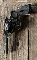 CollaborationJS vintage webley pistol on wooden table Weapons
