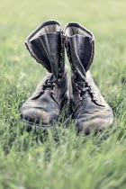Evelina Kremsdorf SCUFFED MENS BOOTS IN FIELD Miscellaneous Objects