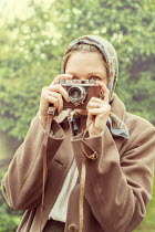 CollaborationJS young vintage woman taking pictures Women