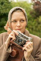 CollaborationJS young vintage woman holding camera Women