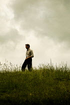 CollaborationJS vintage man walking in cloudy countryside Men