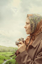 CollaborationJS vintage woman taking photo in countryside Women