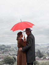 CollaborationJS young vintage couple under umbrella Couples