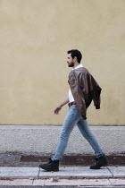 Giovan Battista D'Achille MAN WITH LEATHER JACKET WALKING ON PAVEMENT Men
