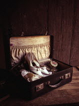 Jane Morley SHOES, CLOTHES AND HAIRBRUSH IN OLD SUITCASE Miscellaneous Objects