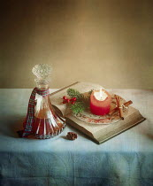 Vesna Armstrong BOOK, CANDLE AND DECANTER ON TABLE Miscellaneous Objects