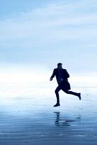 CollaborationJS MAN IN JACKET RUNNING ON SANDY BEACH Men