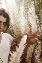 Giovan Battista D'Achille MAN WALKING IN PAMPAS GRASS Men
