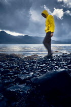 Andy & Michelle Kerry MAN IN YELLOW JACKET WALKING ON SHORELINE Men