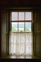 Vesna Armstrong WINDOW OF COTTAGE WITH CURTAIN Interiors/Rooms