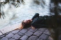 Anna Rakhvalova DREAMY WOMAN LYING BY RIVER Women