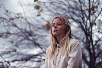 Anna Rakhvalova THOUGHTFUL WOMAN BY TREE IN WINTER Women