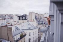 Anna Rakhvalova WOMAN WATCHING CITY FROM HIGH WINDOW Women