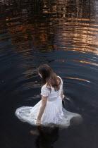 Aleah Ford WOMAN IN DRESS STANDING IN WATER Women
