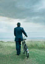 Stephen Mulcahey A  man dressed in forties clothing  holding a bike