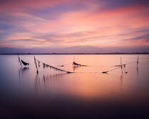 Christophe Dessaigne FISHING NETS IN SEA AT SUNSET Seascapes/Beaches