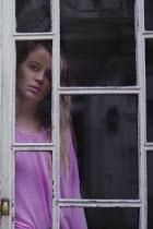 Anna Rakhvalova SAD WOMAN WATCHING BEHIND WINDOW Women