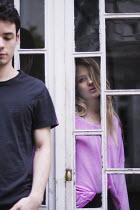 Anna Rakhvalova WOMAN INDOORS WATCHING MAN OUTDOORS Couples