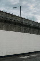 Colin Hutton TALL CONCRETE WALL WITH WIRE Miscellaneous Buildings