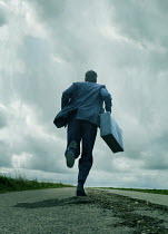 CollaborationJS MAN WITH SUITCASE RUNNING ON ROAD Men