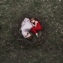 Jovana Rikalo TWO GIRLS LYING IN NEST OUTDOORS Women