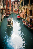 Michael Trevillion VENETIAN CANAL WITH TOURISTS ON GONDOLAS Miscellaneous Cities/Towns
