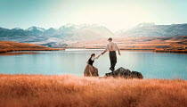 Mary Wethey COUPLE CLIMBING ON ROCK BY LAKE IN SUMMER Couples