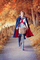 Lee Avison 1940s nurse riding a bicycle on an autumn lane