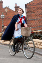 Lee Avison 1940s nurse riding a bicycle in wartime