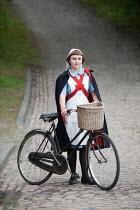 Lee Avison 1940s nurse with bicycle