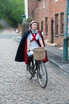 Lee Avison 1940s nurse riding a bicycle