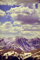 Jill Battaglia SNOWY MOUNTAINS WITH BLUE SKY AND CLOUDS Rocks/Mountains