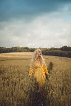 Joanna Czogala BLONDE GIRL STANDING IN WHEAT FIELD Women
