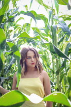Stephen Carroll GIRL IN FIELD OF CORN IN SUMMER Women