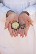 Mohamad Itani Hands of woman holding antique pocket watch Women