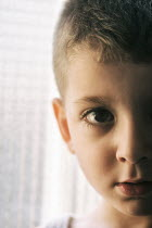 Mohamad Itani Close up of boy by window Children