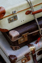 Ute Klaphake STACK OF RETRO SUITCASES TIED WITH STRING Miscellaneous Objects